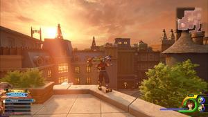Sora admire un crépuscule depuis un toit de la ville.