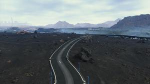 Un vaste paysage déchu avec trois routes toutes neuves qui forment une intersection.