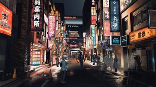Le quartier de Karumocho, de nuit, avec de nombreux panneaux lumineux et des piétons remplissant la rue.