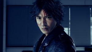 Gros plan sur le visage de Takayuki, avec le front en sang et l'air énervé.